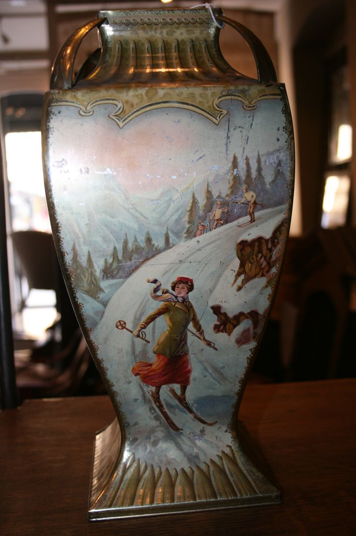 Antique tin vase