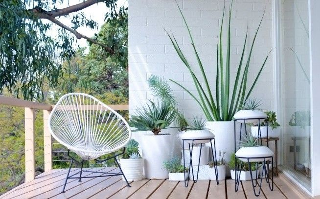 This summer, we're choosing a classic, unobtrusive color—that would be white, or perhaps the palest of grays—for patio pots and planters. Here are 10 we're currently coveting: