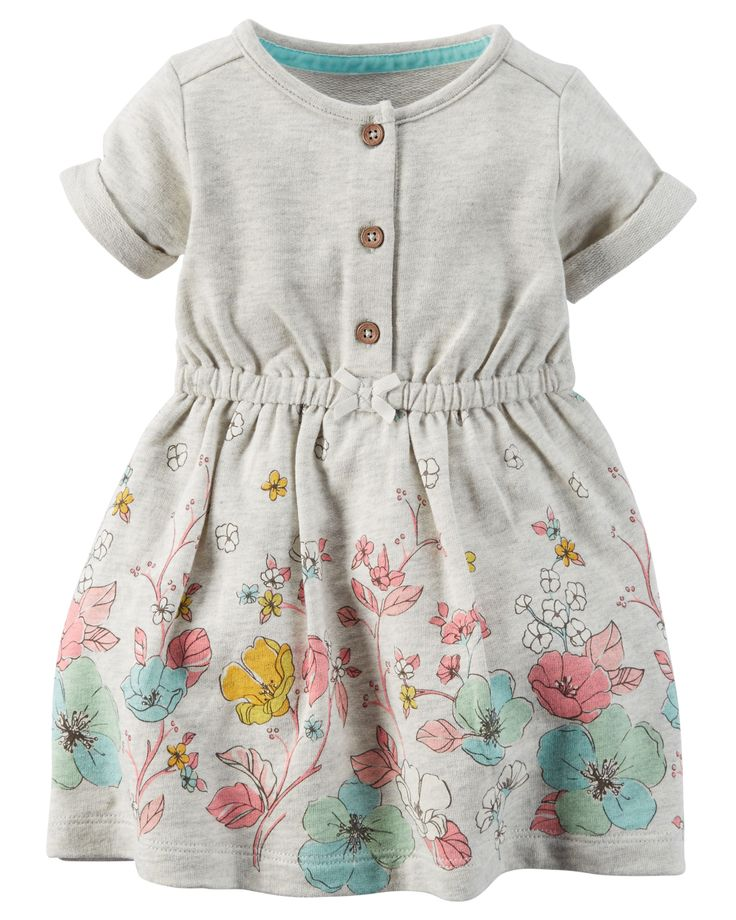 With a floral-print hem, this cozy terry dress was made for sunny play dates.