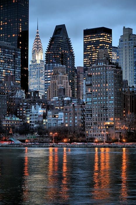NYC. Midtown at dusk from East River looking SW