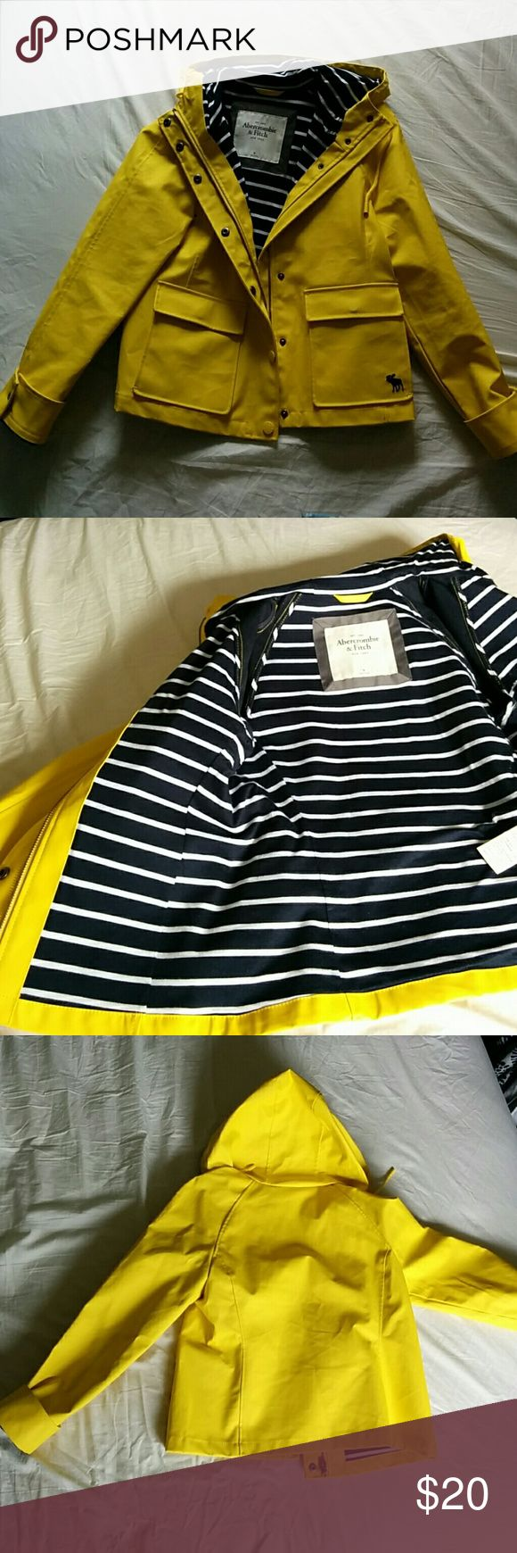 Cute Yellow Rain Coat from Abercrombie and Fitch This is a super cute yellow raincoat from Abercrombie & Fitch. Its insides have blue and white stripes. It has barely been worn and it is super water resistant.   Pet free and smoke free home. Abercrombie & Fitch Jackets & Coats