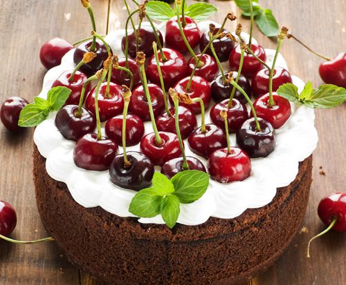 Chocolate cake with whipped cream and sweet cherries :)
