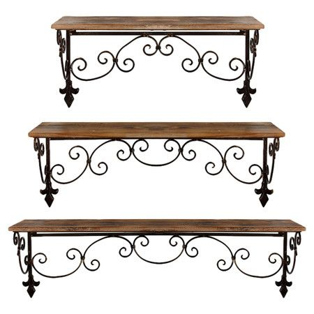 Set of 3 scrolling iron and wood wall shelves with fleur-de-lis detail. Product: Small, medium and large wall shelfCons...