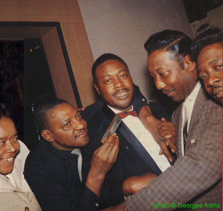 """Hanging out in Muddy's basement at 4339 South Lake Park Ave., Chicago, IL: James Cotton, Sonny Boy Williamson, Jimmy Rogers, Muddy Waters, Otis Spann (1959); source: Front page of Block - Tijdschrift voor Blues #85 (jan/feb/mrt '93); photographer: Georges Adins (""""met dank aan Kees van Wijngaarden""""); James Cotton's face pasted from http://www.youtube.com/watch?v=BmoNlTH66_8 by Stefan Wirz"""
