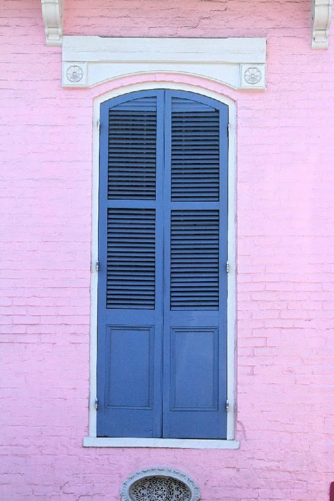 Classic New Orleans Style Blue Exterior Shutters On Pink