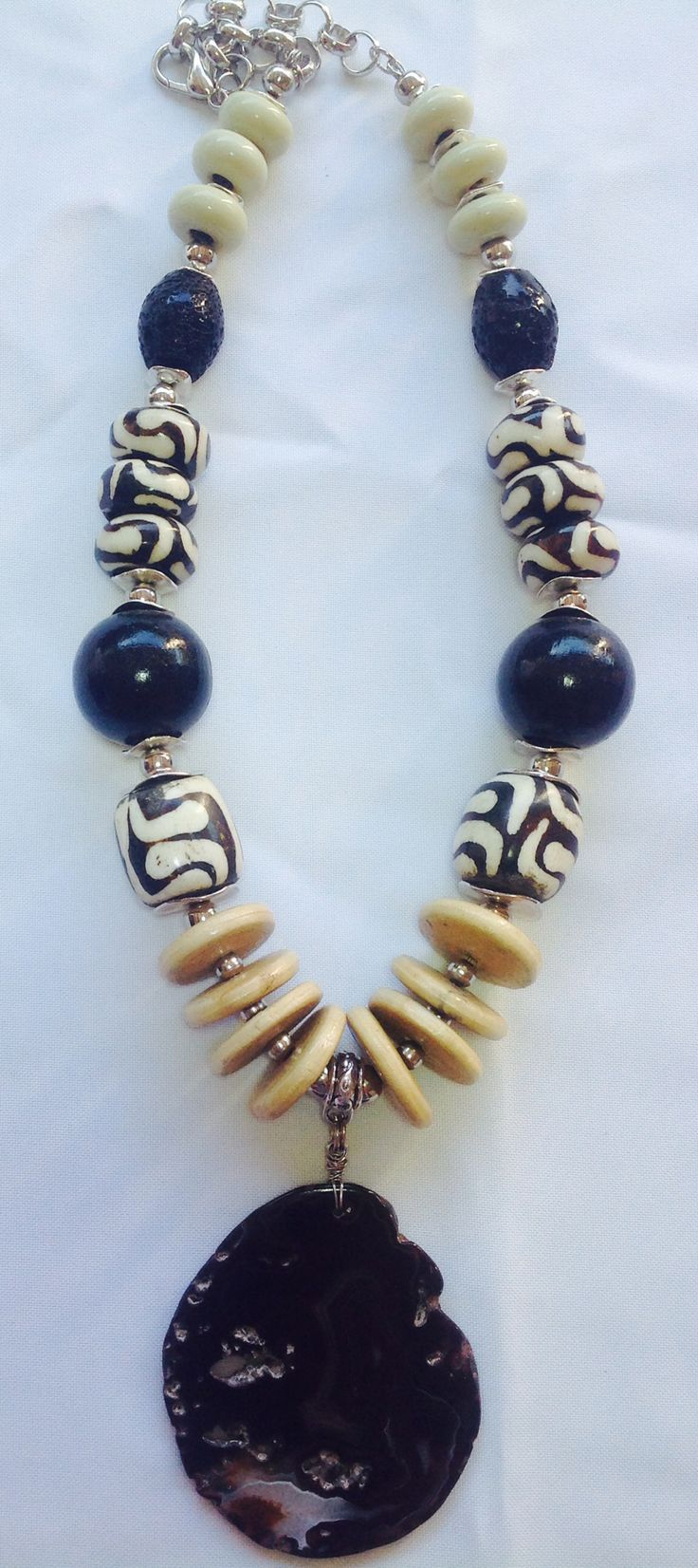 Chunky African tribal necklace, medium length: Large natural black agate pendant, wood discs, batik bone, black wood beads - Michela Rae