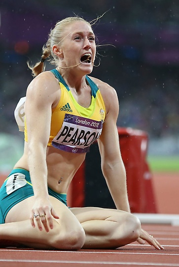 Sally Pearson of Australia reacts after winning the gold medal in the Women's 100m Hurdles Final.