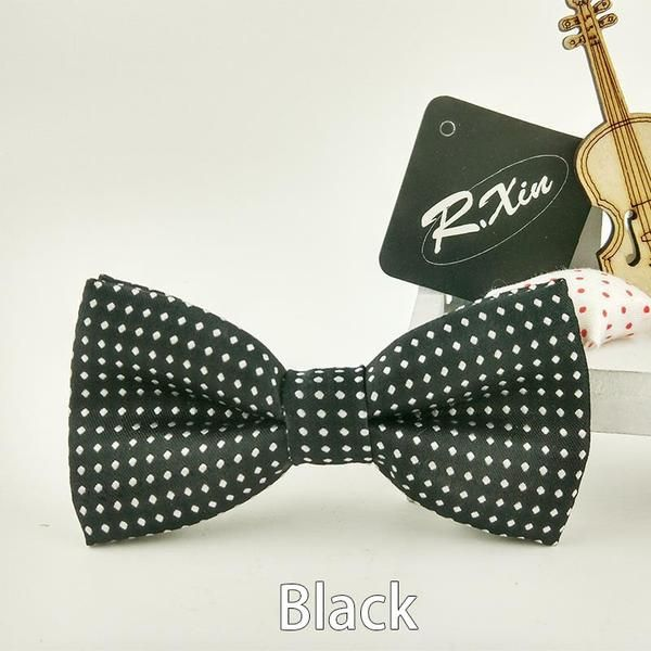 @thetieguys Our kids bow ties come in black to bright purple and all colors in between. With most of The Tie Guys kids bow ties the polka dots are white and do stand out.