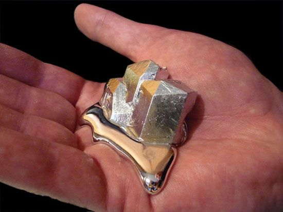 """""""Gallium is a silvery metal with atomic number 31.  It's melting point is only about 85 degrees Fahrenheit. If you hold a solid gallium crystal in your hand, your body heat will cause it to slowly melt into a silvery metallic puddle. Pour it into a dish, and it freezes back into a solid."""""""