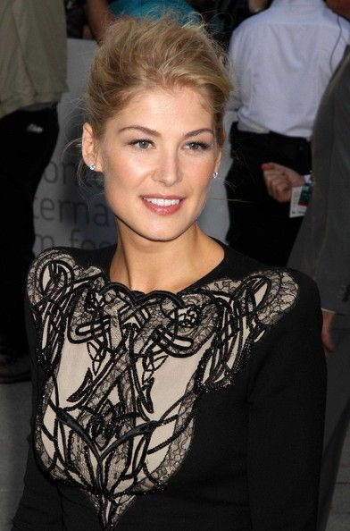 Hair Lookbook: Rosamund Pike wearing Messy Updo (5 of 6). Rosamund wears her natural blond locks in a messy updo for this modern look.
