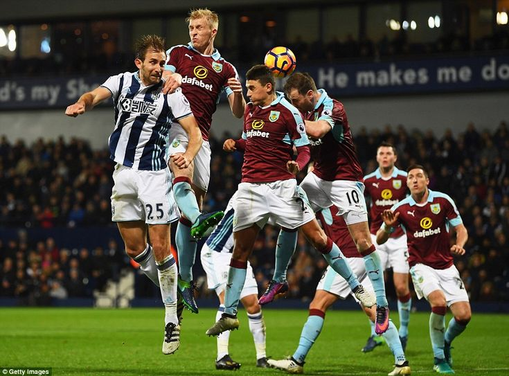 Craig Dawson of West Brom attempts to head the ball in front of Burnley defenders Matthew Lowton and Mee