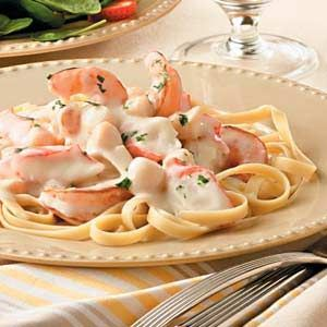 Alfredo+Seafood+Fettuccine.    This rich and creamy pasta dish with three types of seafood comes together in moments.