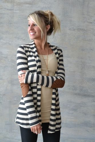 We love this cardigan and have it available on our website. Super cute with patch sleeves and stripes!