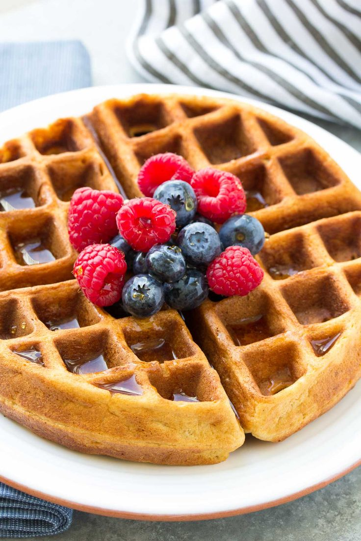 Tried and True Best Easy Healthy Waffle and Pancake Recipe! This simple batter makes light and fluffy pancakes and delicious waffles, too! Made with honey, whole wheat and refined sugar free! | www.kristineskitchenblog.com