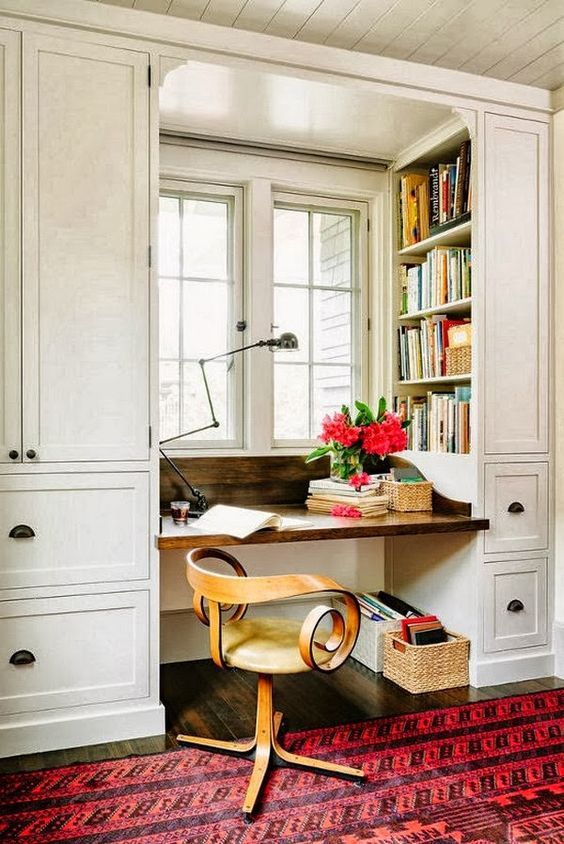 Art Deco chair and vintage industrial lamp transform a little desk niche under the window into a lovely home office space. Get more inspiration in our post, Modern Home Office: (Work, Work, Work) | Hudson Valley Lighting