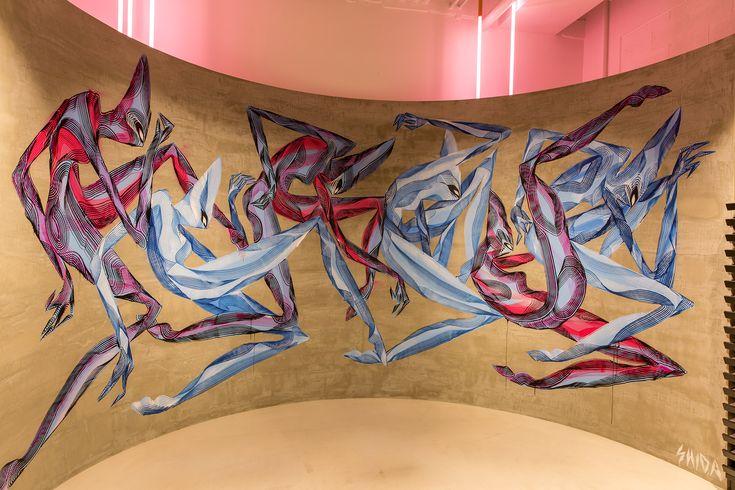 Brisbane artist Mik Shida is the first to paint a mural in 'The Circle' –a feature art wall inside Ironlak Art & Design Sydney.