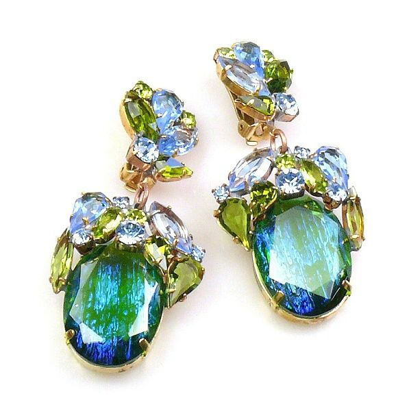 "Fiore Clips Earrings ~ Silver Green with Olive and Blue. Extravagant earrings with clips designed from hand made crystal stones with additional sterling silver, length 3.00""    . Price: $32.90"