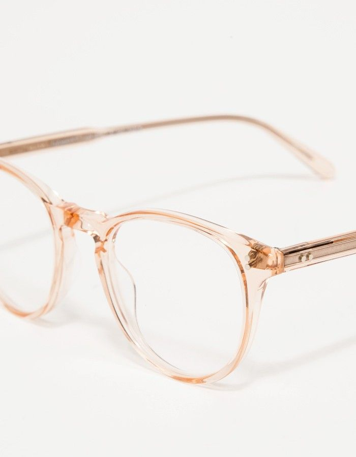 From Garrett Leight, rounded acetate sunglass frames with an iconic shape. Features keyhole bridge, pink crystal finish, and clear lenses.   • Rounded acetate Pink Crystal sunglasses • Pure clear lenses • Keyhole bridge