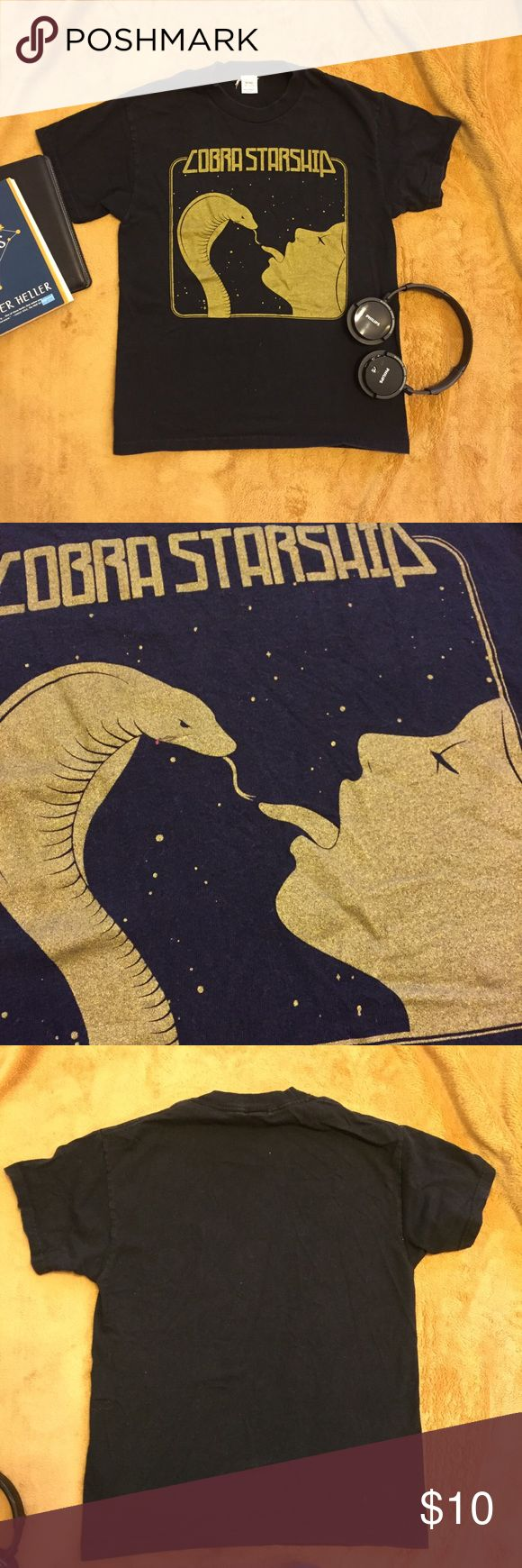 """Cobra Starship Band Tee w/ Metallic Gold Print T-shirt from the pop band Cobra Starship circa 2006. Eye-catching design is printed in metallic gold.   Shirt is in great condition, no stains or holes. The print itself is also in good condition, not worn down.  Measurements:  Bust 34"""" Waist 34"""" Shoulder to shoulder: 15.5"""" Tops Tees - Short Sleeve"""