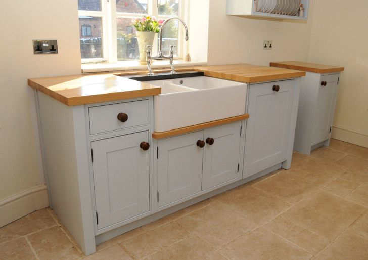Furniture. Affordable Prefab Kitchen Cabinets Design. standing white stained wooden kitchen cabinet using cream butcher block top built in white ceramic appron front undermount sink