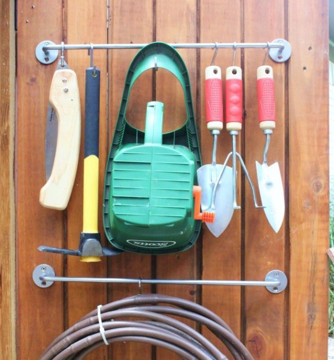 Keeping tools close to hand- Garden tools can be stored on towel rails. Now there's no need to have them getting dirty in piles on the floor! Plus, they'll be easier to find this way.
