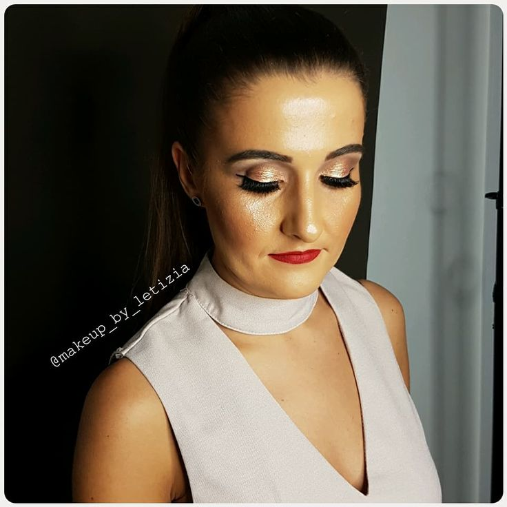 Bronze eye, winged liner, killer lashes and a hot red lip! @makeup_by_letizia