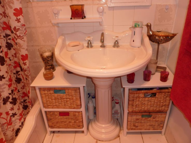 Small bathroom - not sure about colors - but the idea of storage under a pedestal sink is good