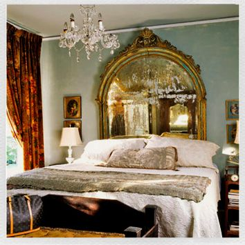 gilded mirror headboard + soft turquoise walls + rusty red drapes + feminine bedroom + luxurious