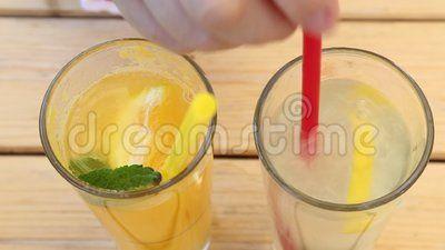 Two glasses of lemonade - oranges in the left and of lemon in right side.