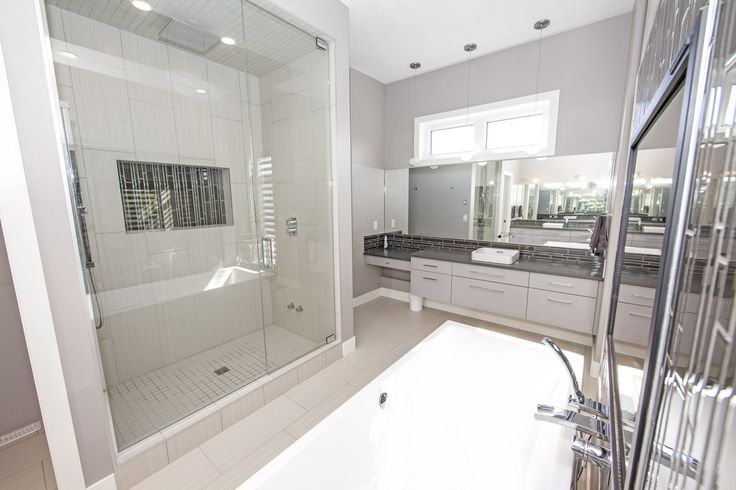 10MM Door and Panel to ceiling - custom glass shower enclosure done by Top Shelf Closets and Glass - what a great looking shower door!