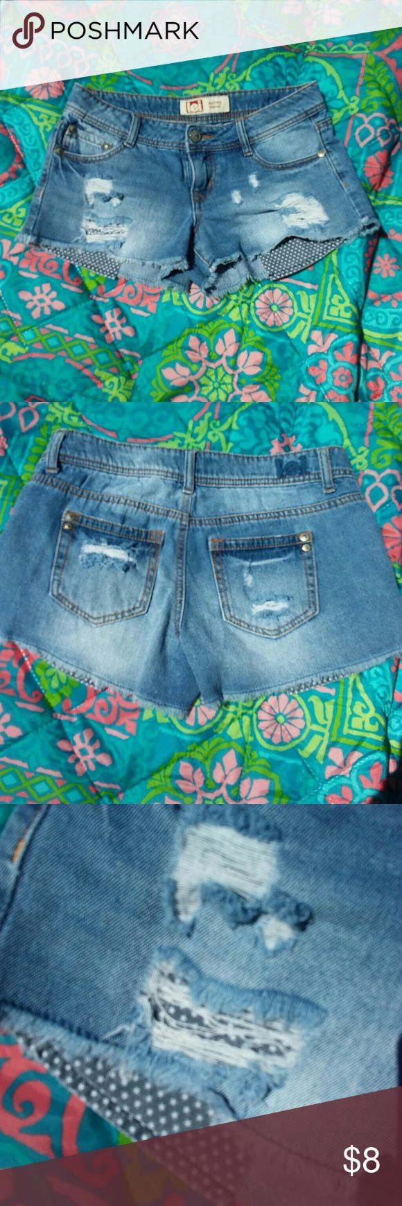 Star Pocket Jean Cutoffs Destroyed cutoffs with exposed star print pockets. Size 3 Lei Shorts Jean Shorts