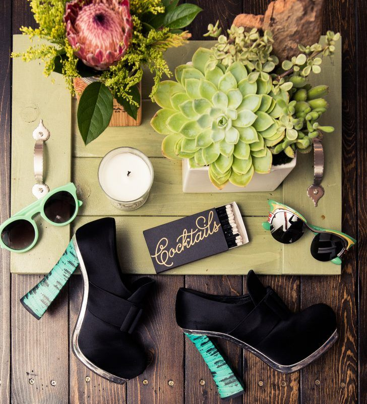 Inside Fashion Stylist Sophie Lopez's Closet: Two Pairs of Green Sunglasses by Prada, Black and Green High Heels by Miu Miu, Succulent and Candle Decor | coveteur.com