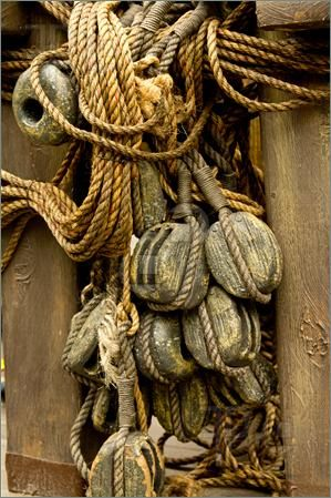 Picture of An old rope and wooden block pulleys of an old pirate ship