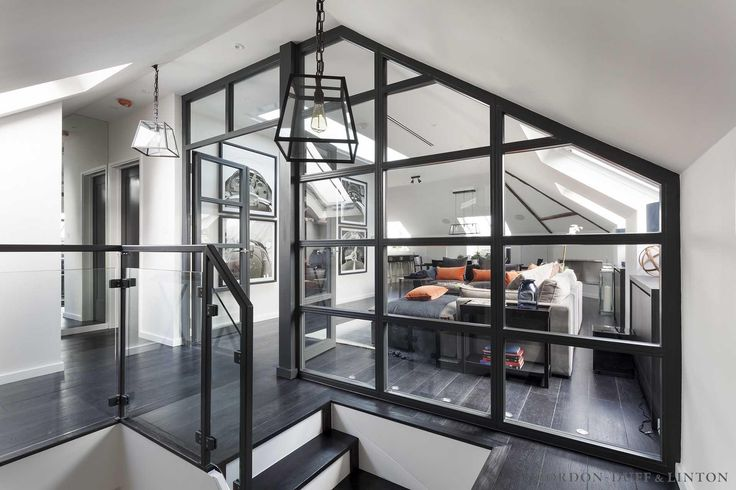 View through crittall windows in hallway to penthouse living room in Victorian conversion.