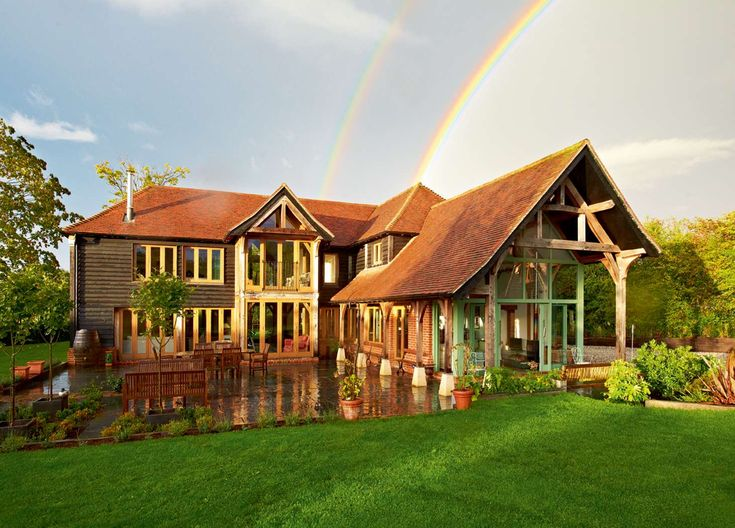 Oak Frame Guide | Homebuilding & Renovating  Like the glass and wood but not the panelling barn look