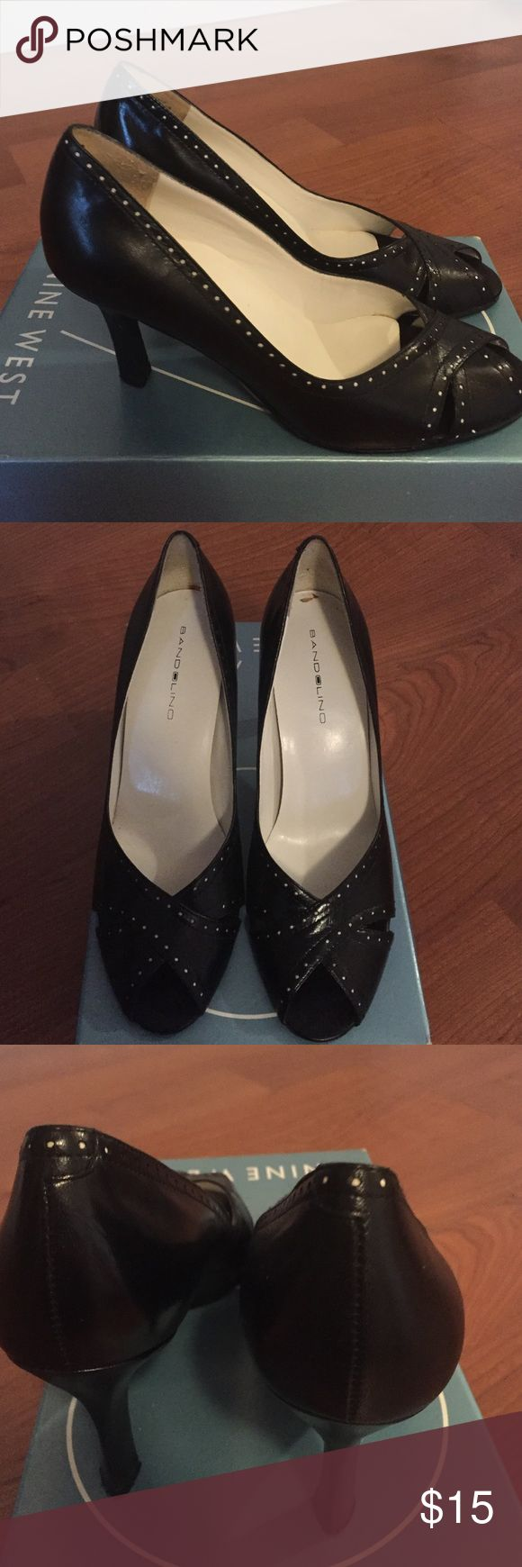 Peep toe pump Gently used peep toes pumps. Black with white dot detail. Super comfortable Bandolino Shoes Heels