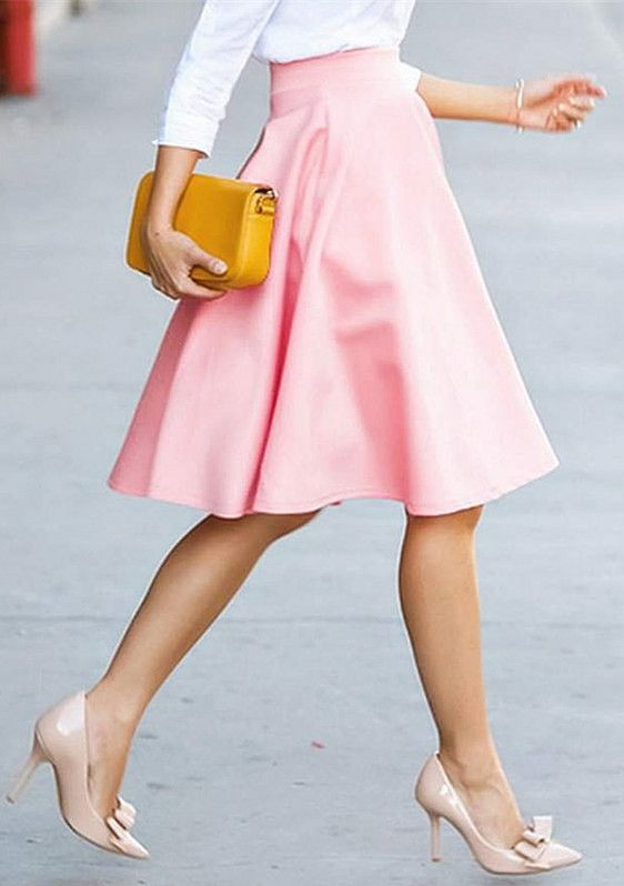 If you have a white shirt but don't want to be too professional, wear this pink skirt to make you nifty and not serious.Victoria also wore it!