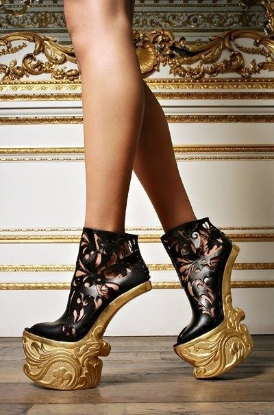 Black and gold heels from Alexander McQueen: just in case you wanna break a foot, a leg or trip and take your knee out