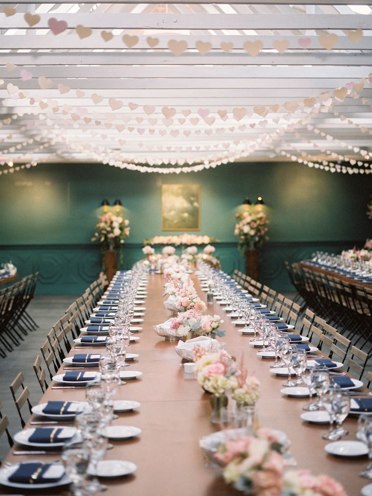 wedding dinner reception with hundreds of paper