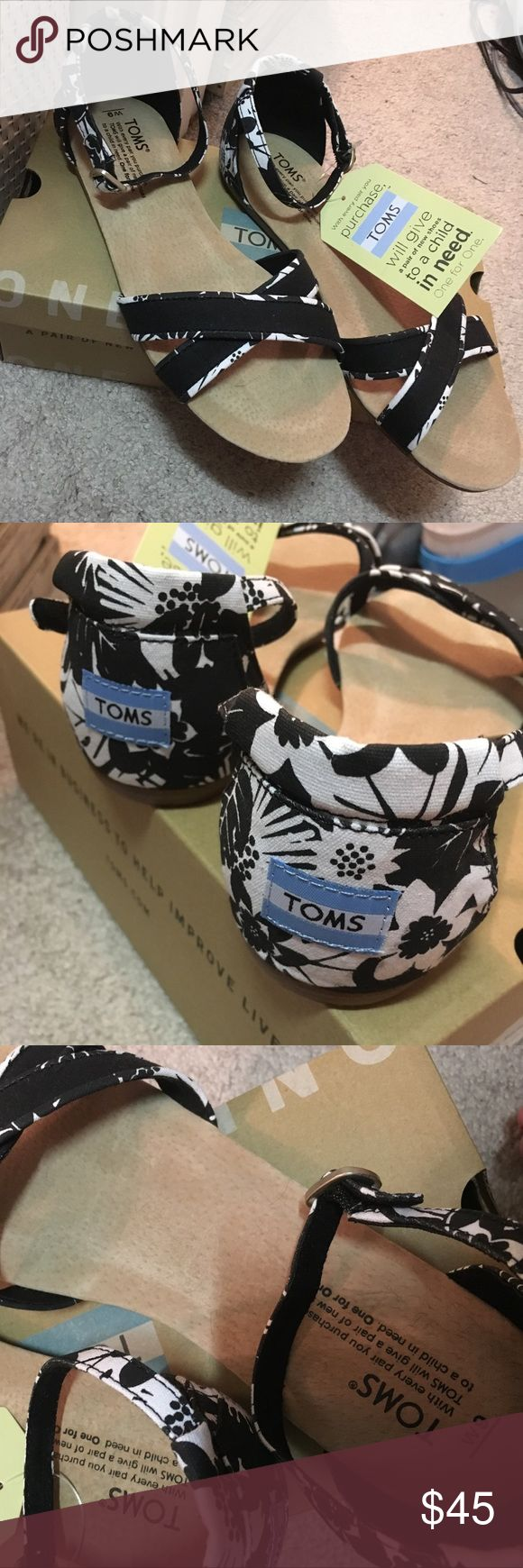 NEW black & white floral TOMS sandals Brand new black & white floral print Toms sandals! Never been worn, tags still attached. Will ship with box. Size 9. Price is firm. TOMS Shoes Sandals