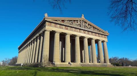 Stock video footage The Parthenon in Nashville is a scale replica of the Greek Parthenon.  That's what makes this site so impressive.  This is a time-lapse shot of the building against a clear blue ...