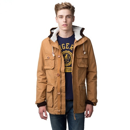 A modern interpretation of a tough, authentic parka. Outfitted with plenty of pockets and warm teddy lining at hood. Waist adjustment inside. Chequered lining. Full zip behind buttoned storm flap. Tommy Hilfiger patch at pocket, flag at sleeve.Our model is 1.86m and is wearing a size M Tommy Hilfiger jacket.