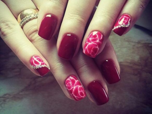 Deep red manicure base with rhinestones & abstract pattern