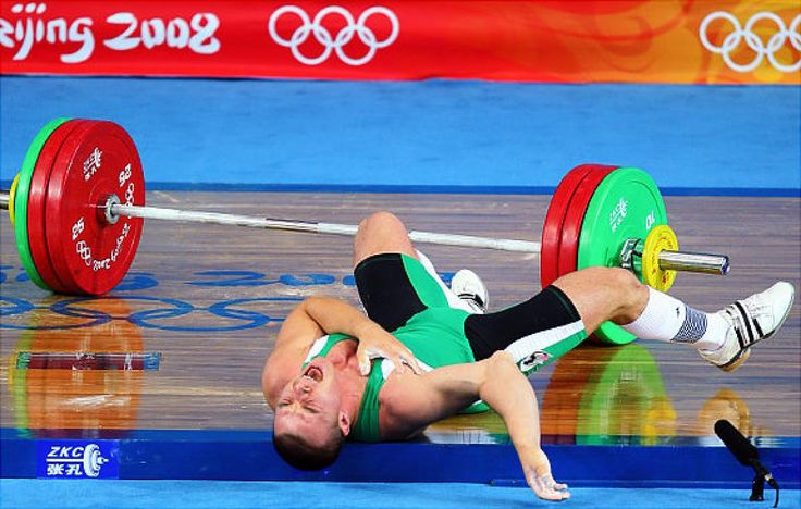 Janos Baranyai of Hungary screams in pain after dropping the weights during the Men's 77kg weightlifting competition event at the University of Aeronautics and Astronautics Gymnasium during Day 5 of the Beijing 2008 Olympic Games on August 13, 2008.