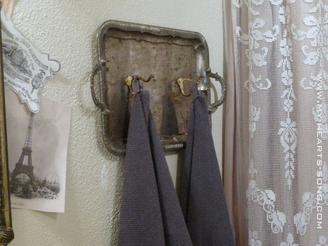 Vintage silver tray turned into towel hooks - lovely!  Shared at the Knick of Time Tuesday Vintage Style party.