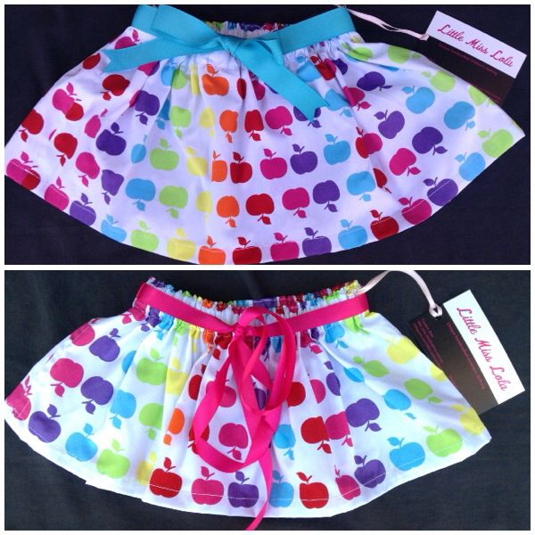 New fabric! Bright & cute apple print with either aqua blue or fuschia pink belt. Sizes 6mths-5yrs. $25. Go to www.facebook.com/littlemisslolas for more designs or to order..