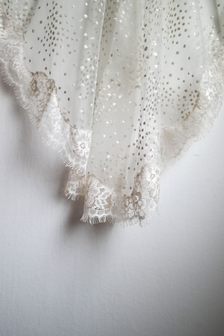 Asteria is as spellbinding as the star-covered sky at nighttime. With her casually placed ivory clusters of glitter, she takes the dot veil to the next level. She is a classic standard cut veil with a chantilly style lace running around the edges. Asteria is that thrilling mix of when classic tradition meets the unconventional and she will add bit of magic to the wherever she is. Photo: Teres Arvidsson & Wernerskapet Model: Christine