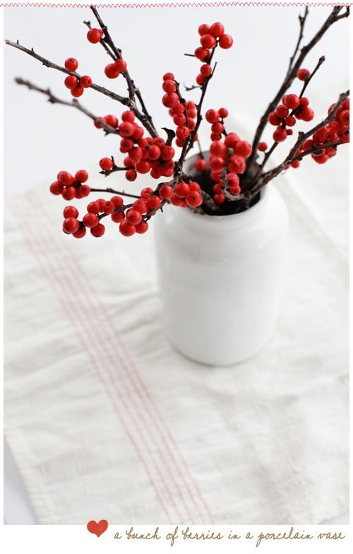 Christmas centerpiece! red berried and white vase... great for the holidays or for a wedding!