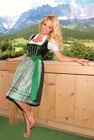 Pamela Anderson in a green and white dirndl.