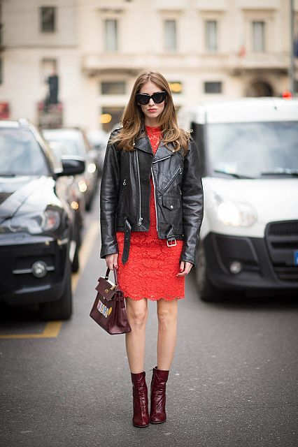 Red lace Valentino dress, Louis Vuitton boots, ShopJayDee customized leather jacket andHermès Kelly vintage bag with stickers by Anya Hindmarch.